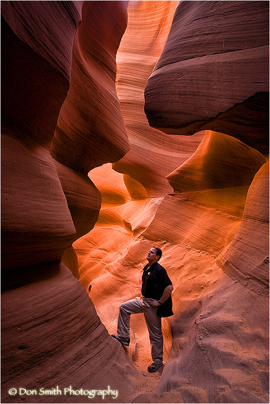 Photographer examines Lower Antelope Canyon.