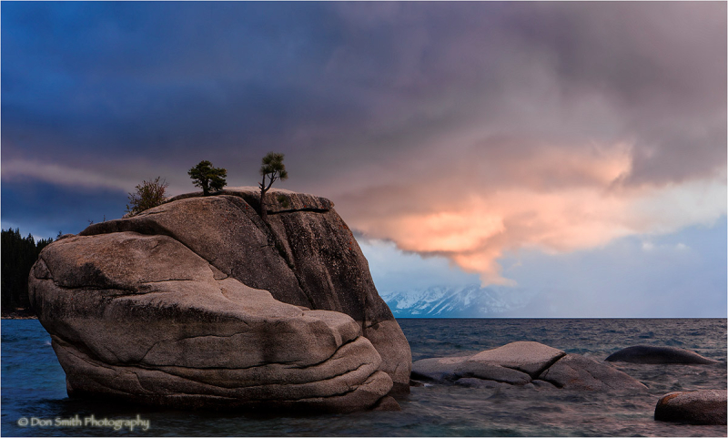 Sunset lit cloud over Bonsai Rock, Lake Tahoe.