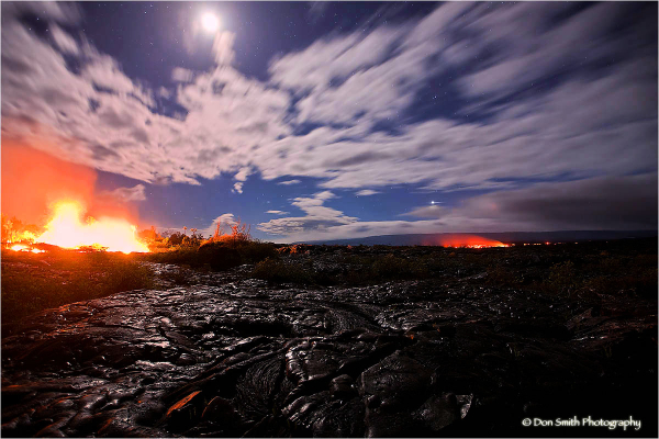 Molten lava from Kilauea flows over dried lava.