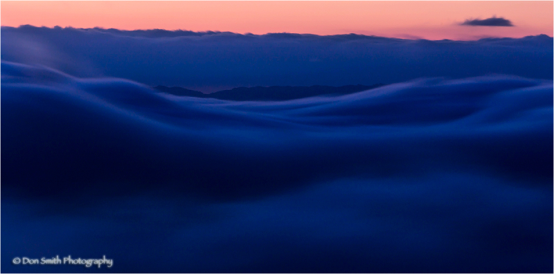 Moving fog at dusk over Monterey Bay, California.