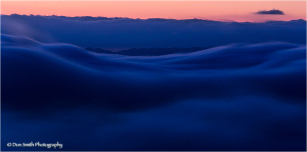 Moving fog at dusk over Monterey Bay, California.