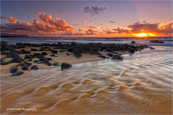 Sunrise over Nukoli'i Beach, Kauai, Hawaii.