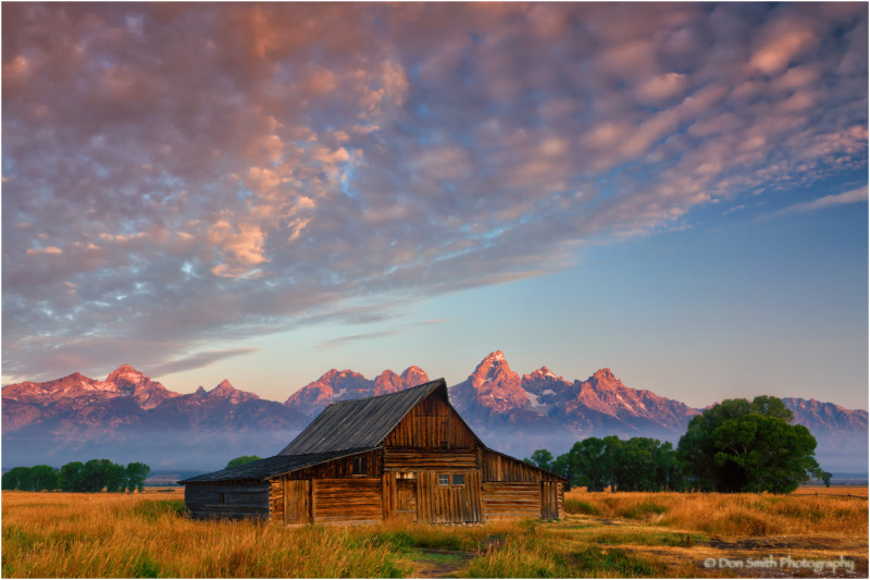 Old barn and Grand Tetons at sunrise, Jackson Hole