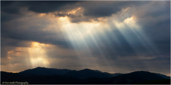 Crepuscular rays over mountains, San Jose, Ca