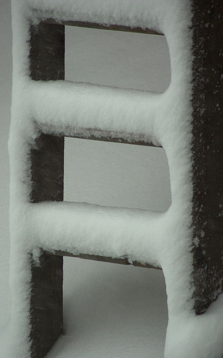 ladder under snow