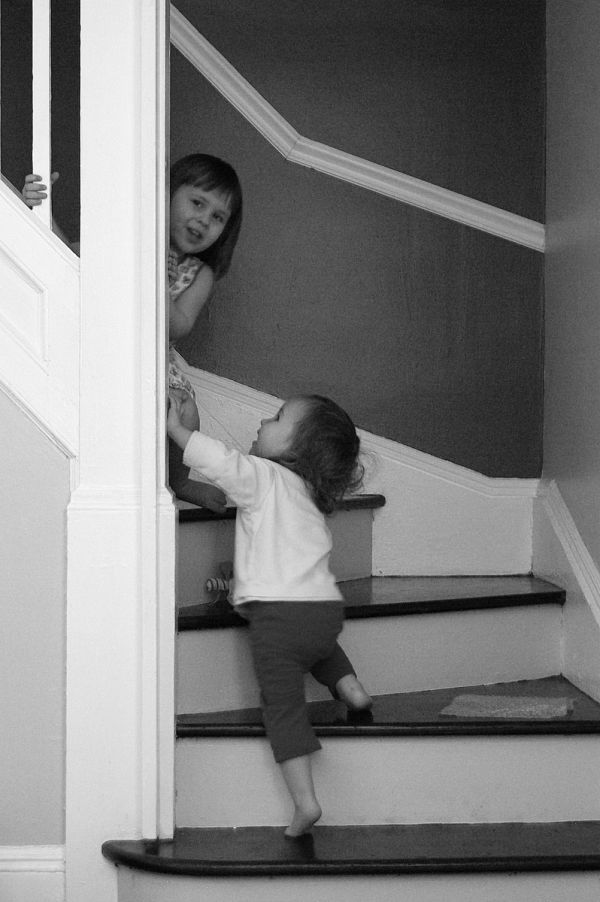 girls are playing on the stairs