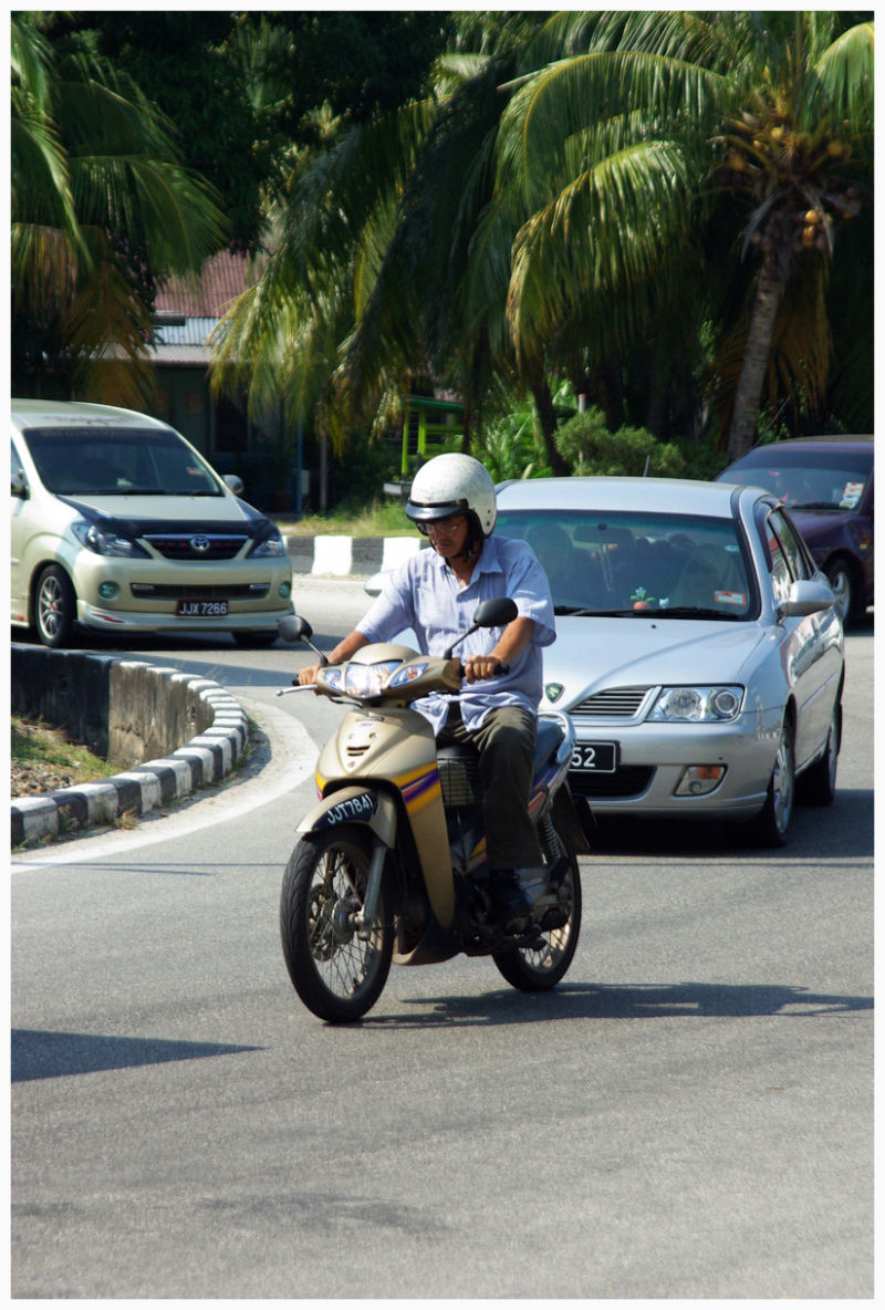 man driving motorcycle