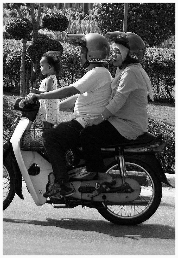 family driving the motorcycle