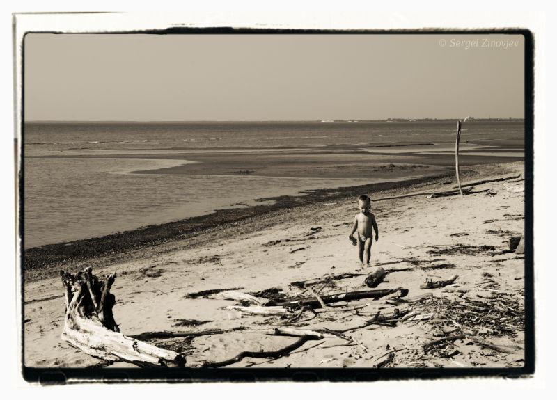 little boy walking on the beach