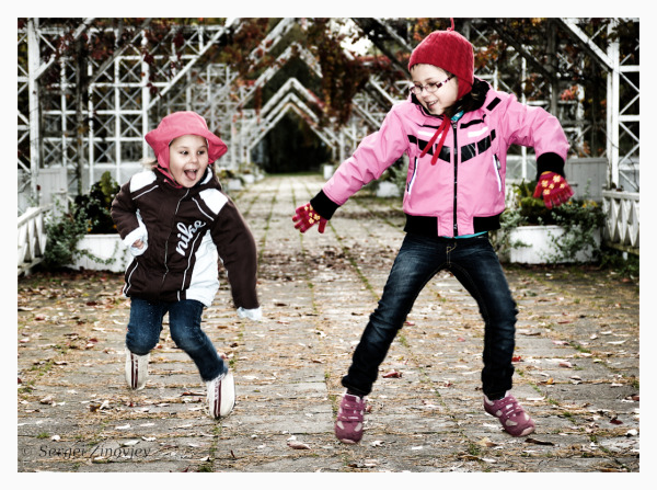 two girls jumping and having fun