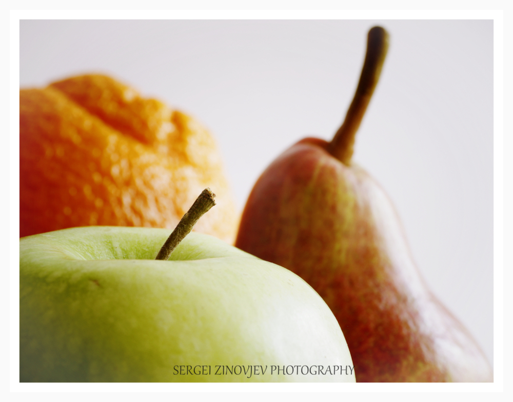 close-up of apple, pear and orange.