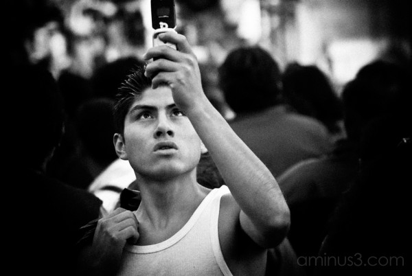 Capturing the moment on the cell phone.