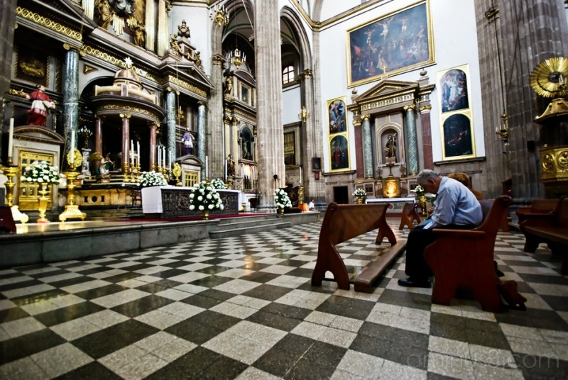 A man prays at San Judas Tadeo, Centro Historico.