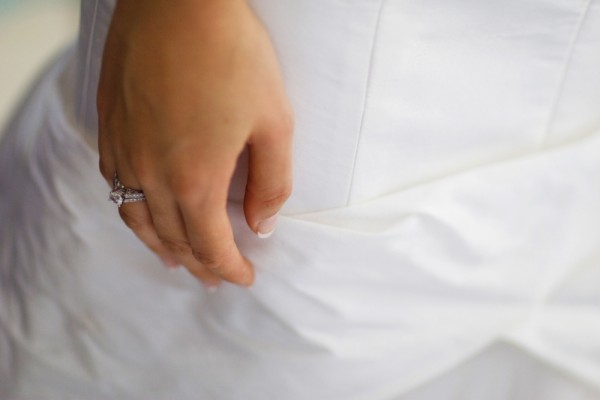 Bride with engagement ring on