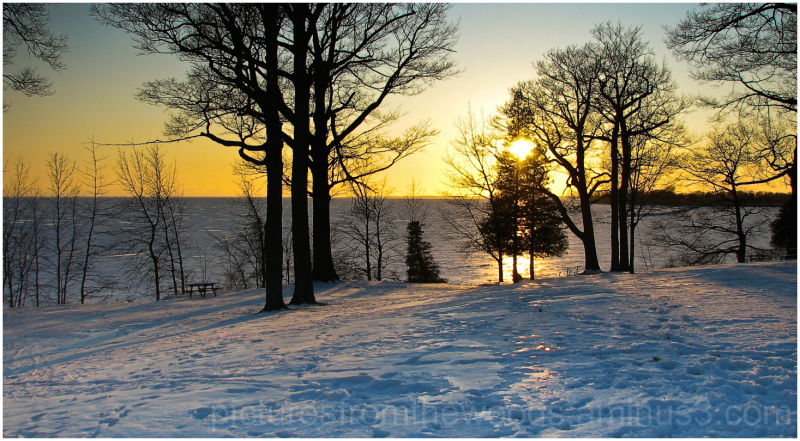 Sunset on frozen Lake Ontario Park