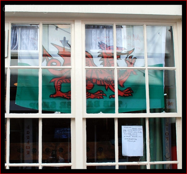 a flag in a window in Caernafon, Wales