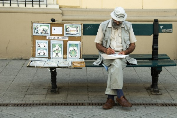 artist on a bench