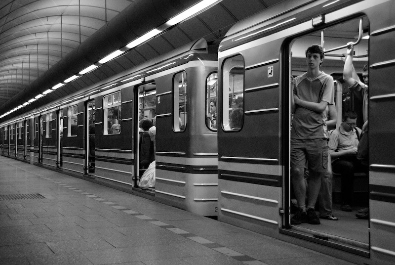 man in subway, black and white