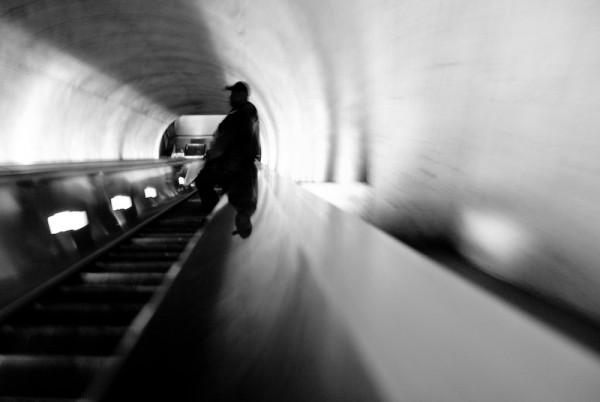 going down escalator in metro