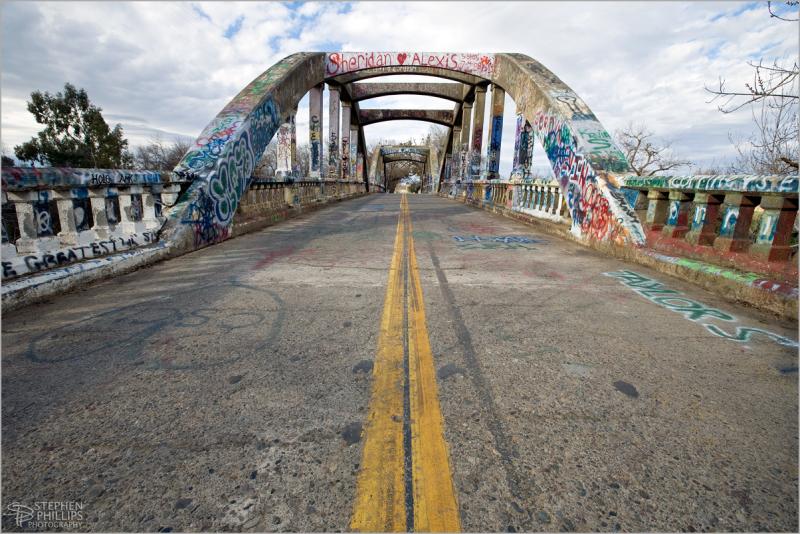 Graffiti covered Stevenson Creek Bridge rainy day