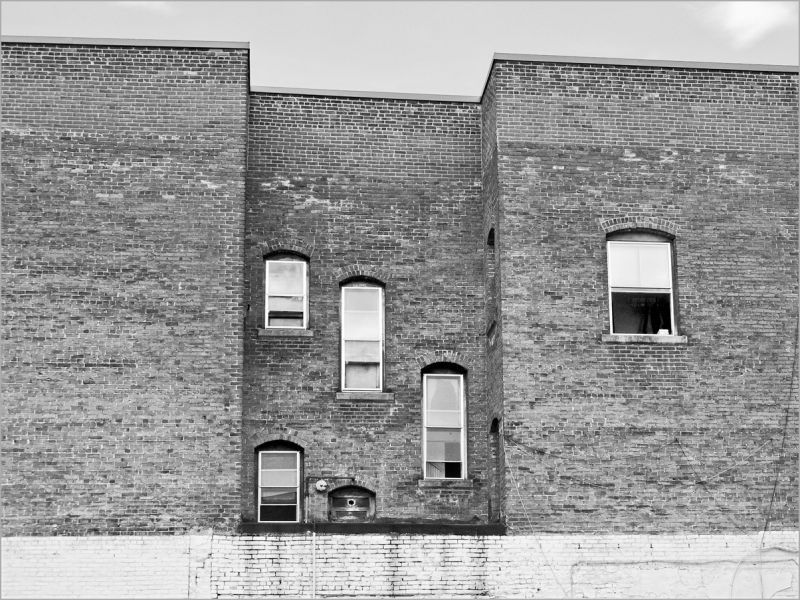 new windows in old brick wall