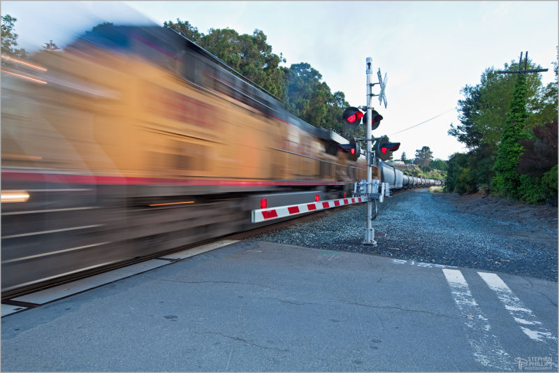 Frieght train crossing a road grade