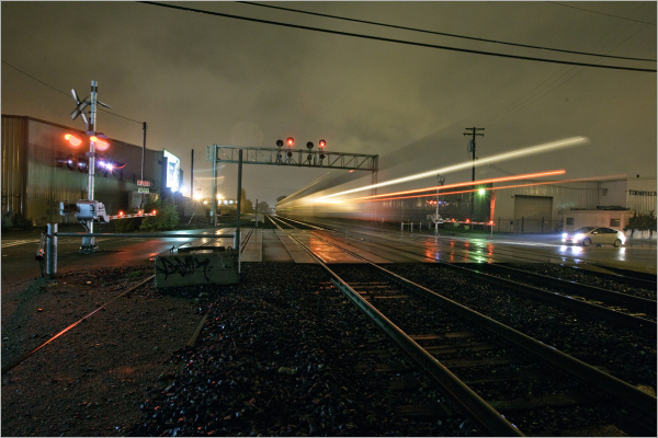train at night in the rain