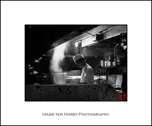Restaurant cook preparing food