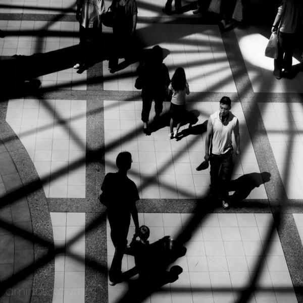 looking down on shadows of people walking