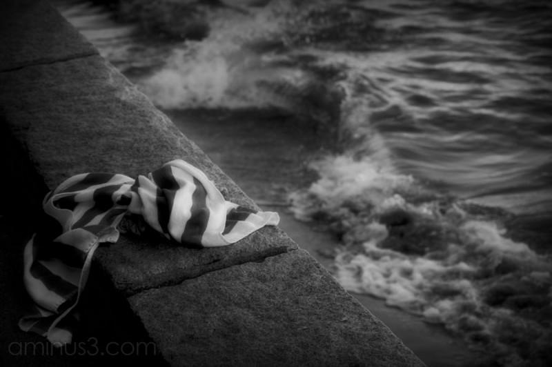 an abandoned towel, ocean waves coming in