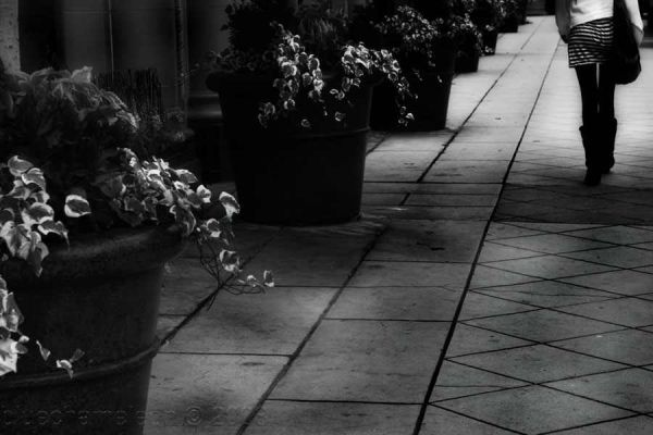a woman walking down a street in Beverly Hills