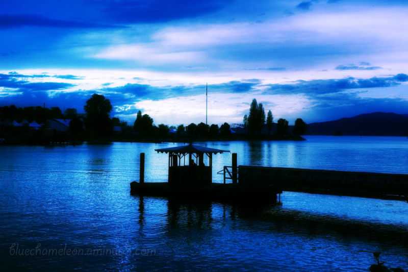 Small ferry station silhouetted in blue at dusk