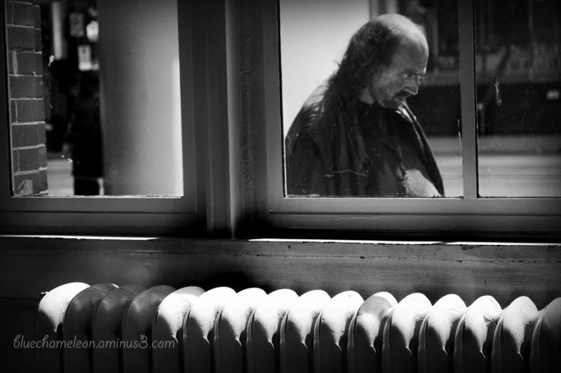 Scary man walking past window outside