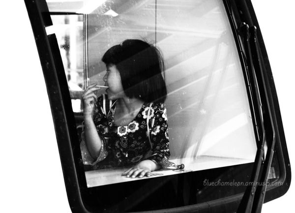 A girl with a lollipop through a train window