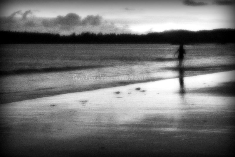 A blurred woman running into the ocean