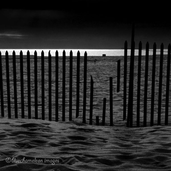 A broken fence along venice beach