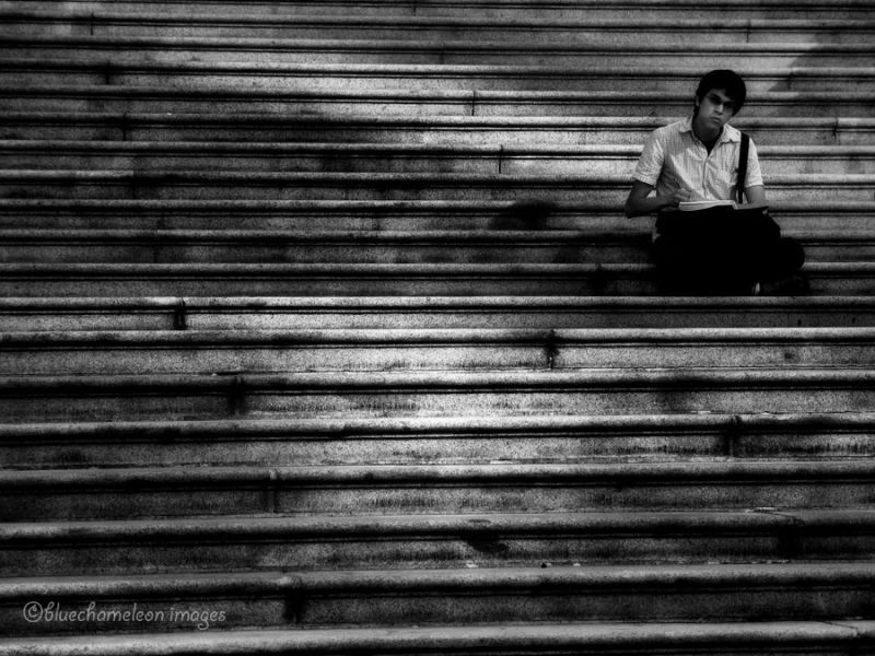 A man sitting on stairs at Vancouver Art Gallery