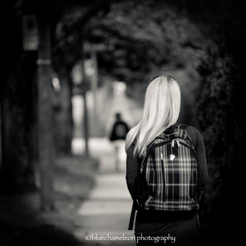 Woman watching a man in bokeh