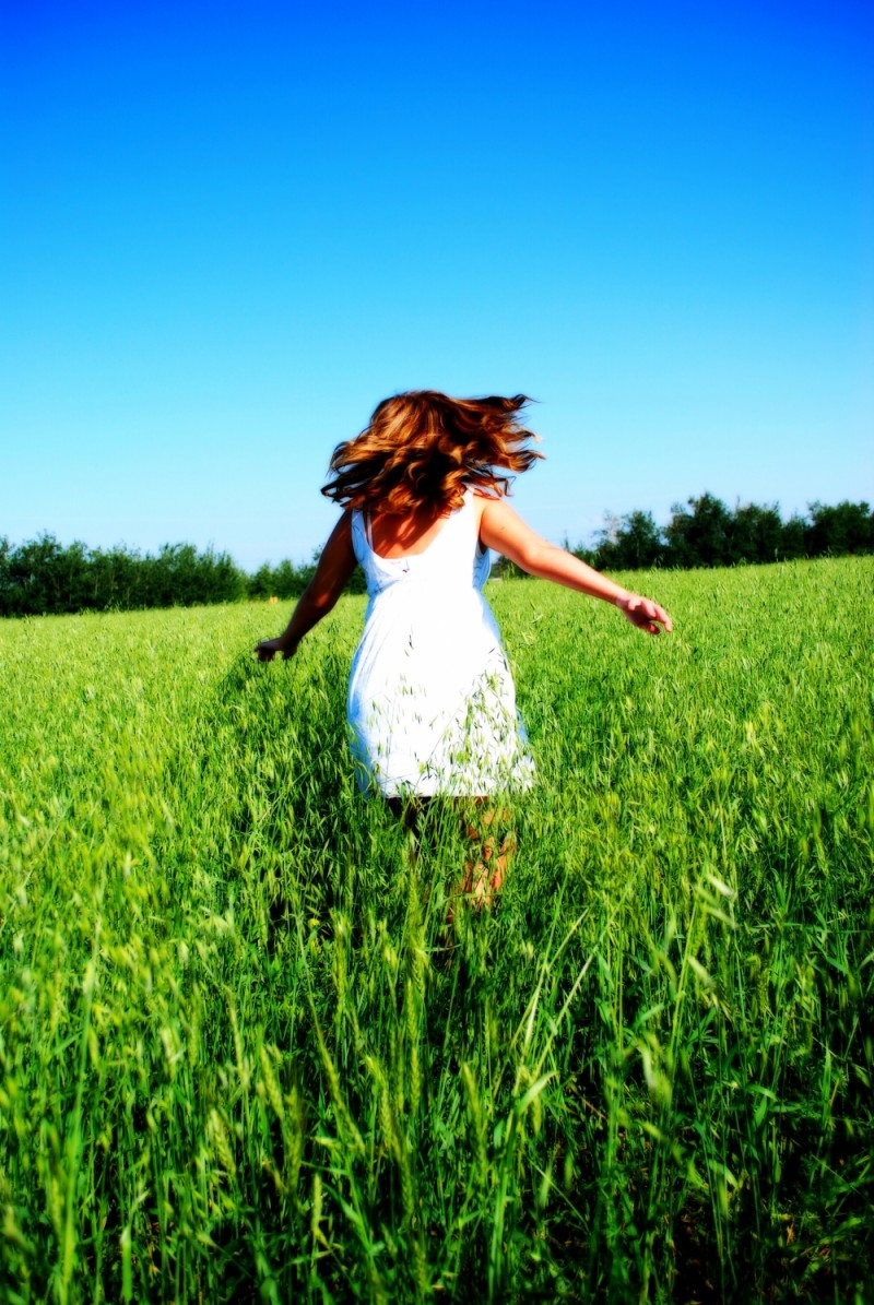 Leigh dancing in a field