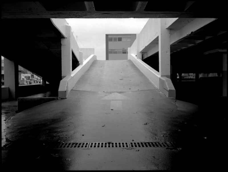 parking garage in the rain - b&w photo