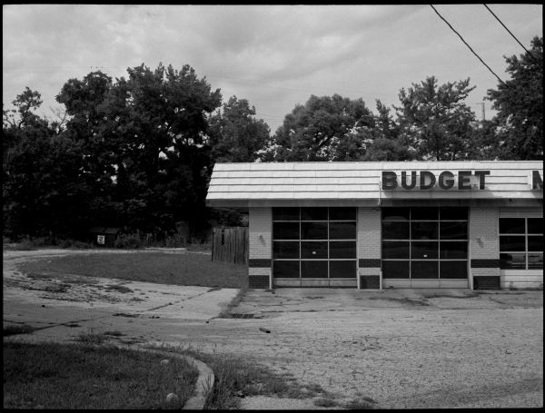 budget muffler building - b&w photo, fuji gs645