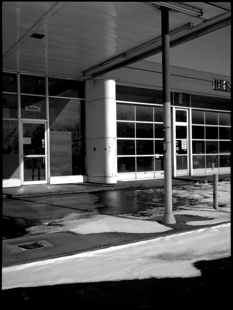 auto shop in snow - b&w photo