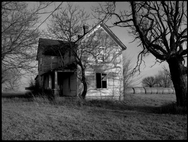 abandoned farm house - b&w photo