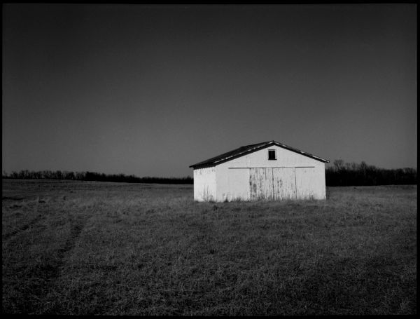 b&w photograph, white barn, rural kansas