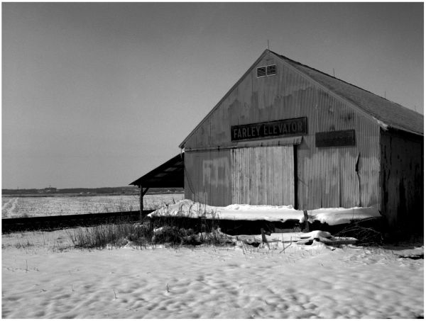 black & white photo, rural snow scene, farm
