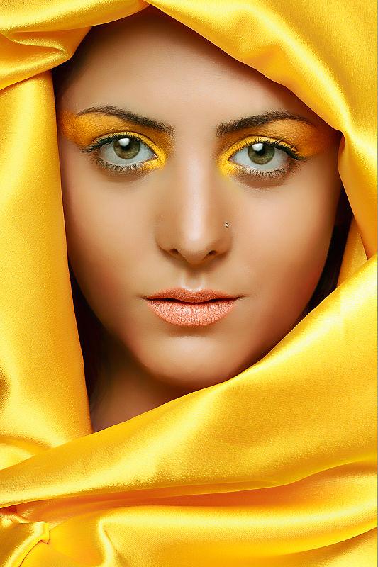 Muslim girl in yellow dress