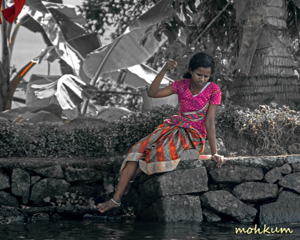 lady fishing river village alleppey
