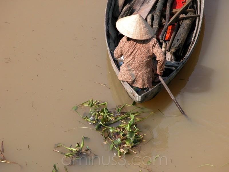 Woman rowing boat in Nha Trang river