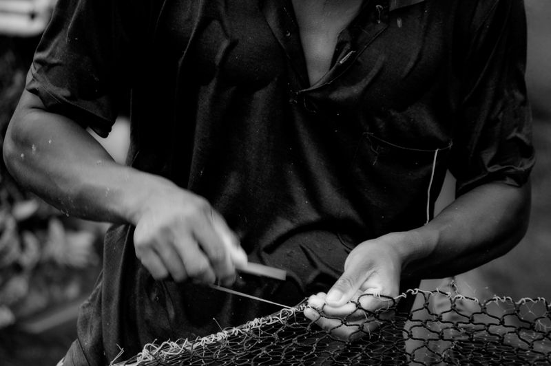 mending fishing net harbor Nathon Koh Samui