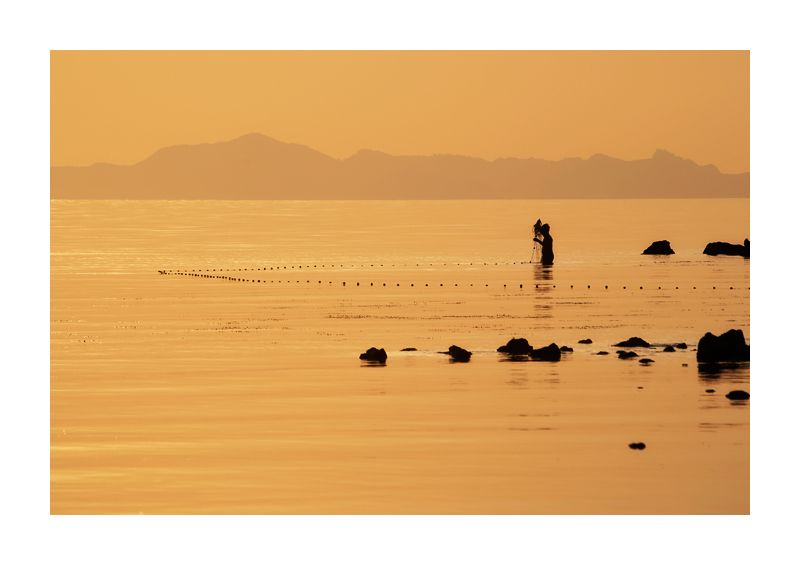 golden hour sunset fisherman at sea